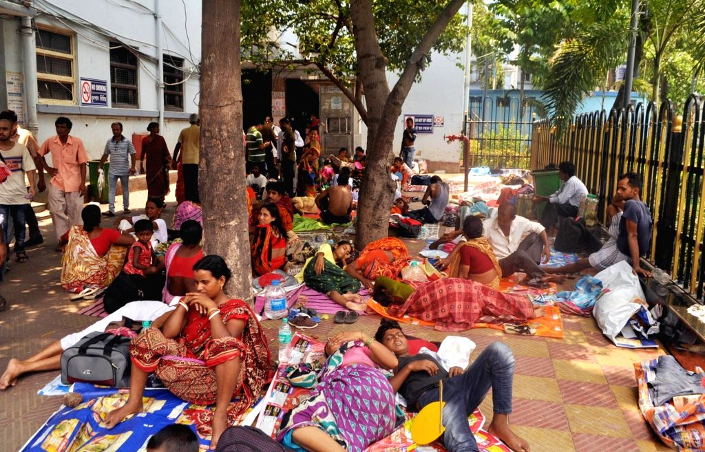 Kolkata: Family members of patients left unattended at the NRS Medical College and Hospital where juniors doctors continued their strike protesting an attack on a colleague at the hospital, in Kolkata on June 12, 2019. (Photo: IANS)