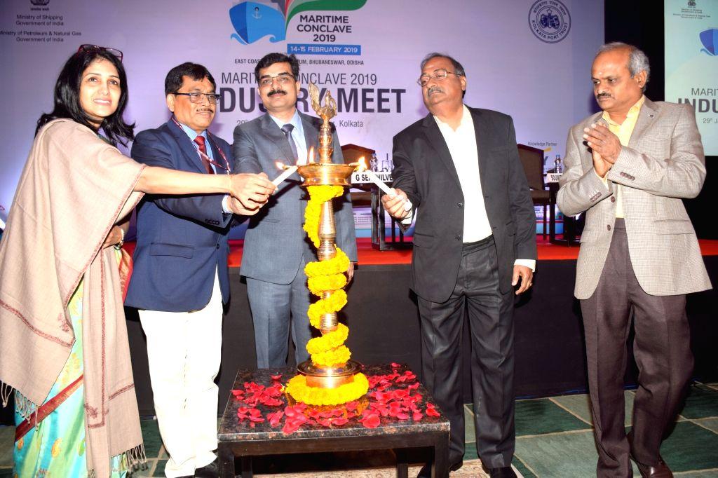 Kolkata: Federation of Indian Chambers of Commerce and Industry (FICCI) Director (Infrastructure) Neerja Singh, Ministry of Shipping Director (Port) Arvind Chaudhary, Kolkata Port Trust (KoPT) Chairman Vinit Kumar, Haldia Dock Complex (HDC) Deputy Ch - Neerja Singh, Arvind Chaudhary and Vinit Kumar