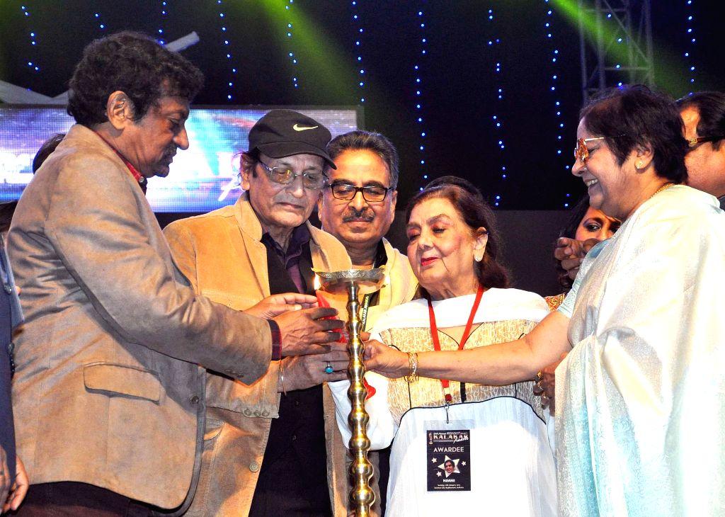 Filmmaker Goutam Ghosh, vetaran actors Biswajit Chatterjee, Nimmi, Lily Chakraborty at the inauguration of the 23rd Kalakar Awards in Kolkata on Jan 11, 2014. - Goutam Ghosh, Biswajit Chatterjee, Nimmi and Lily Chakraborty