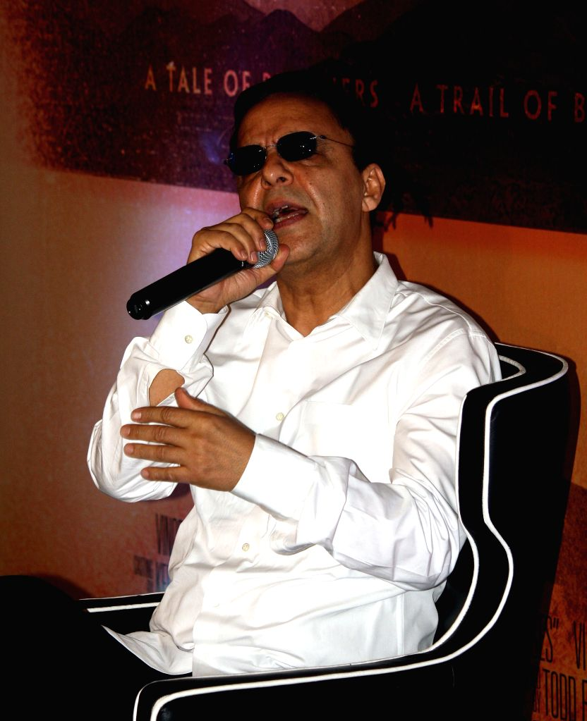 Filmmaker Vidhu Vinod Chopra addresses a press conference regarding his upcoming Hollywood film `Broken Horses` in Kolkata on April 6, 2015. - Vidhu Vinod Chopra