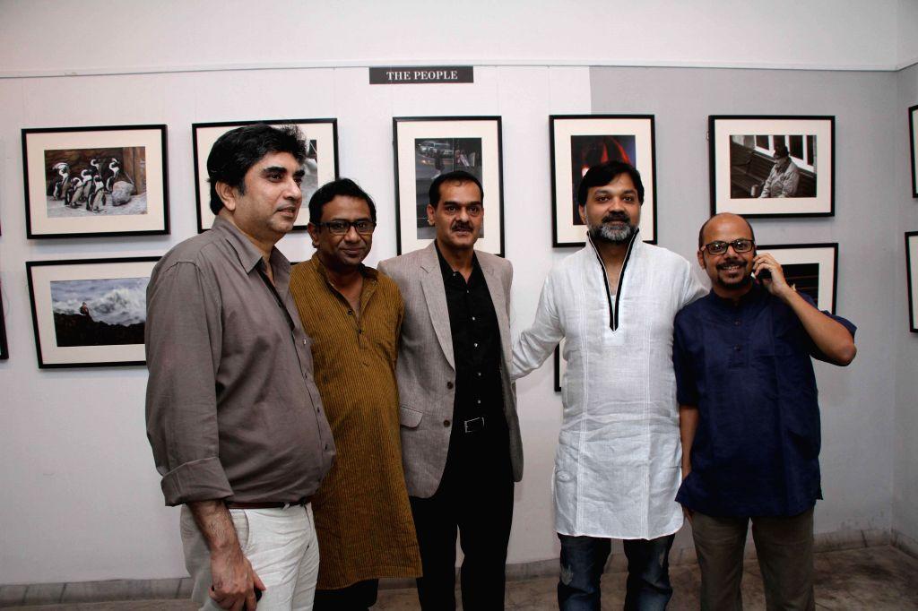 Filmmakers Anik Dutta, Kamaleswar Chatterjee, artist Kaushik Ghosh, filmmaker Srijit Mukherjee and poet Srijato during a photography exhibition in Kolkata on 11 Nov 2014. - Kaushik Ghosh, Anik Dutta, Kamaleswar Chatterjee and Srijit Mukherjee