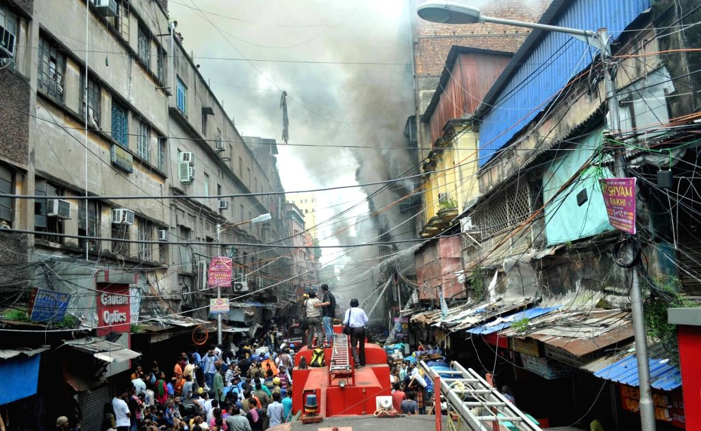 : Kolkata: Fire fighters busy dousing a massive fire that erupted around 2.45 a.m at Bagree Market, a wholesale market in Kolkata on Sept 16, 2018. There were no reports of any casualty or injury. ...