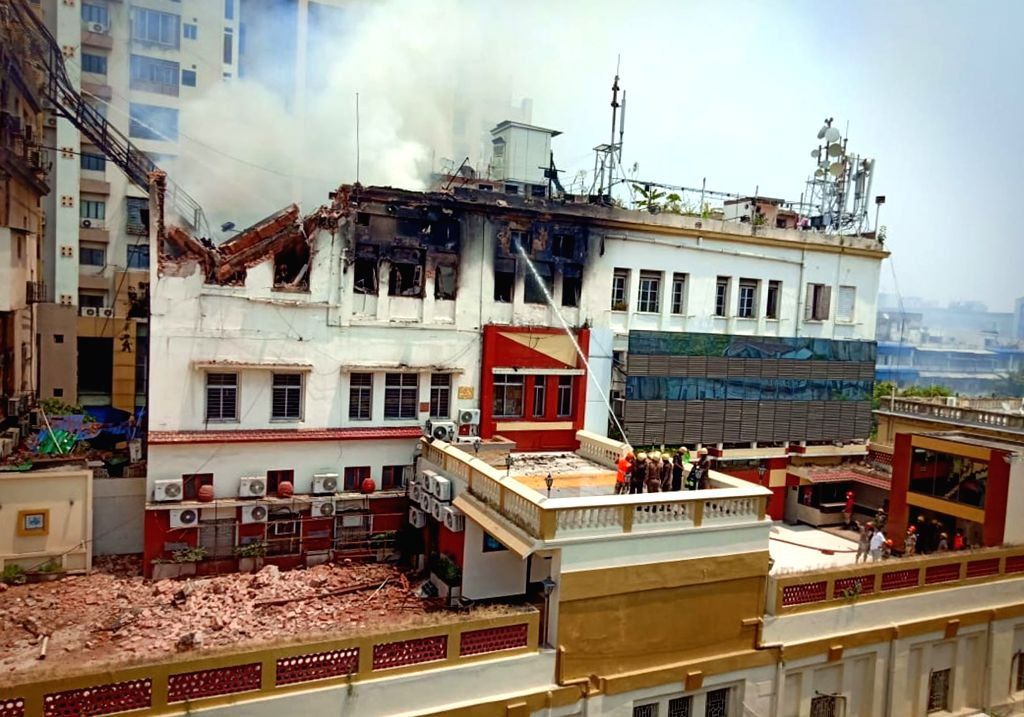 Kolkata: Fire fighters douse a fire that broke out in a four-storeyed building in south Kolkata's bustling Chowringhee Road, in Kolkata, on April 26, 2019. (Photo: IANS)