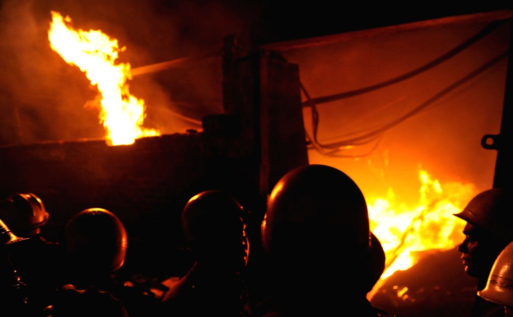 Firefighters strive to douse a fire that broke out in a factory in Kolkata's Topsia on May 4, 2015.