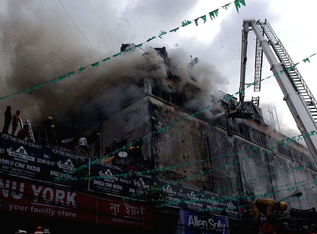 Firefighters try to douse a fire that broke out in a Kolkata shopping mall on April 26, 2015.