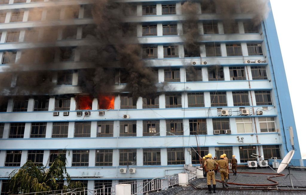 Firemen try hard to douse a fire that broke out at New Secretariat building in Kolkata on April 10, 2015.