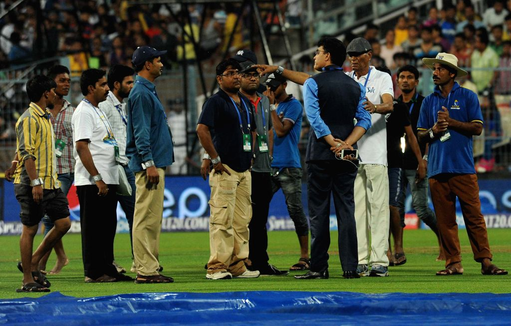 Former India​n​ ​cricketer​ Sourav Ganguly interacts with Eden Gardens` pitch curator Prabir Mukherjee ​​at the Eden Gardens after rains disrupted an IPL-2015 match between ... - Sourav Ganguly and Prabir Mukherjee
