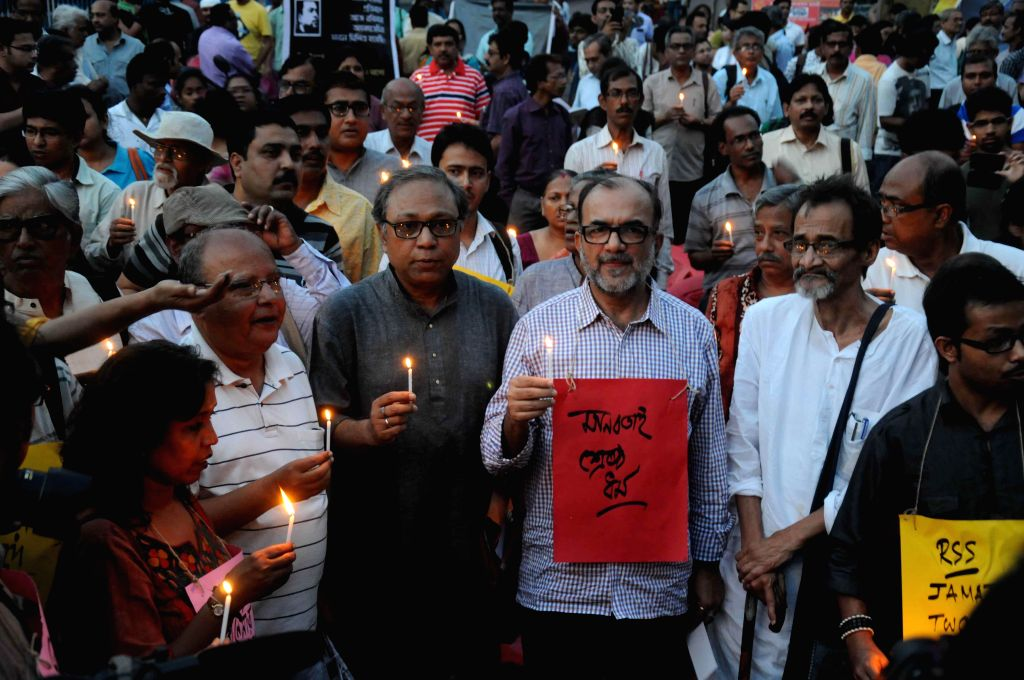 Former mayor of Kolkata Bikash Ranjan Bhattacharya and others participate in a candlelight vigil to pay tribute to Avijit Roy - a prominent American blogger of Bangladeshi origin, who was ...