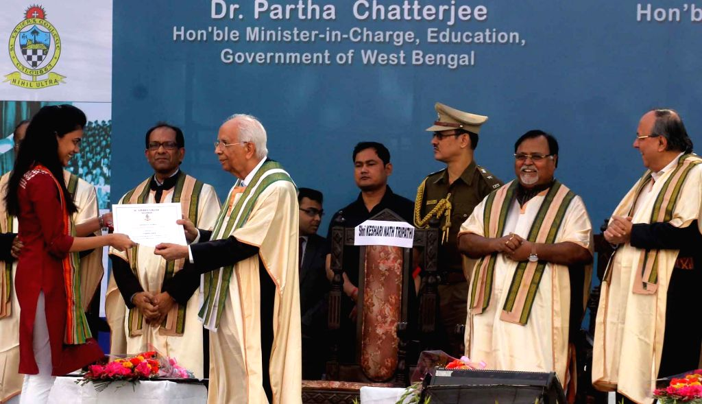 Governor of West Bengal, Keshari Nath Tripathi presenting gold medals to students during the 8th Convocation and Valedictory 2015 of St. Xavier's collage in Kolkata on Jan 17, 2015.