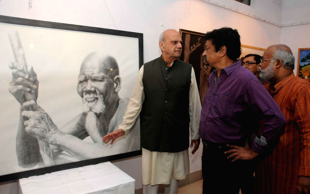 Haider Aziz Safwi with filmmaker Goutam Ghose during inauguration of a painting exhibition - exhibiting paintings made by prisoners, at Academy of Fine Arts in Kolkata on Nov 12, 2014.