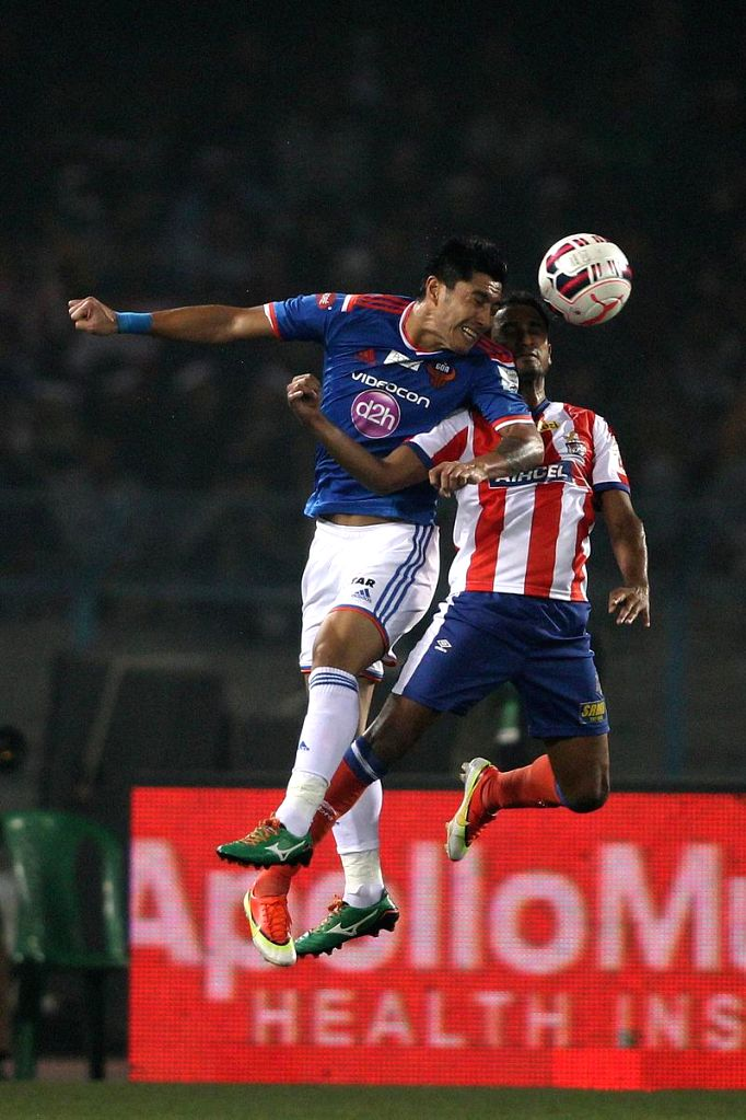 Haroon Fakhruddin of FC Goa and Kinshuk Debnath of Atletico de Kolkata in action during an ISL semi-final match between Atletico de Kolkata and FC Goa in Kolkata, on Dec 14, 2014.