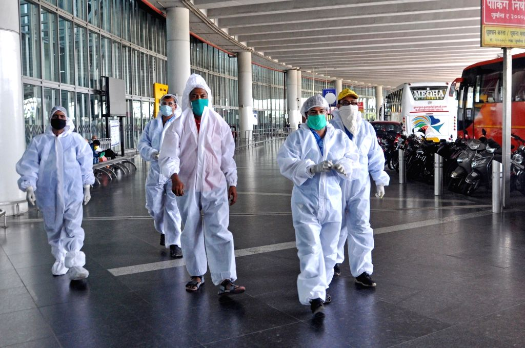Kolkata: Health workers wearing Personal Protective Equipment (PPE) suits deployed at Netaji Subhash Chandra Bose International Airport ahead of the arival of Indian nationals who were stranded in Dhaka via one of the special flights being operated b