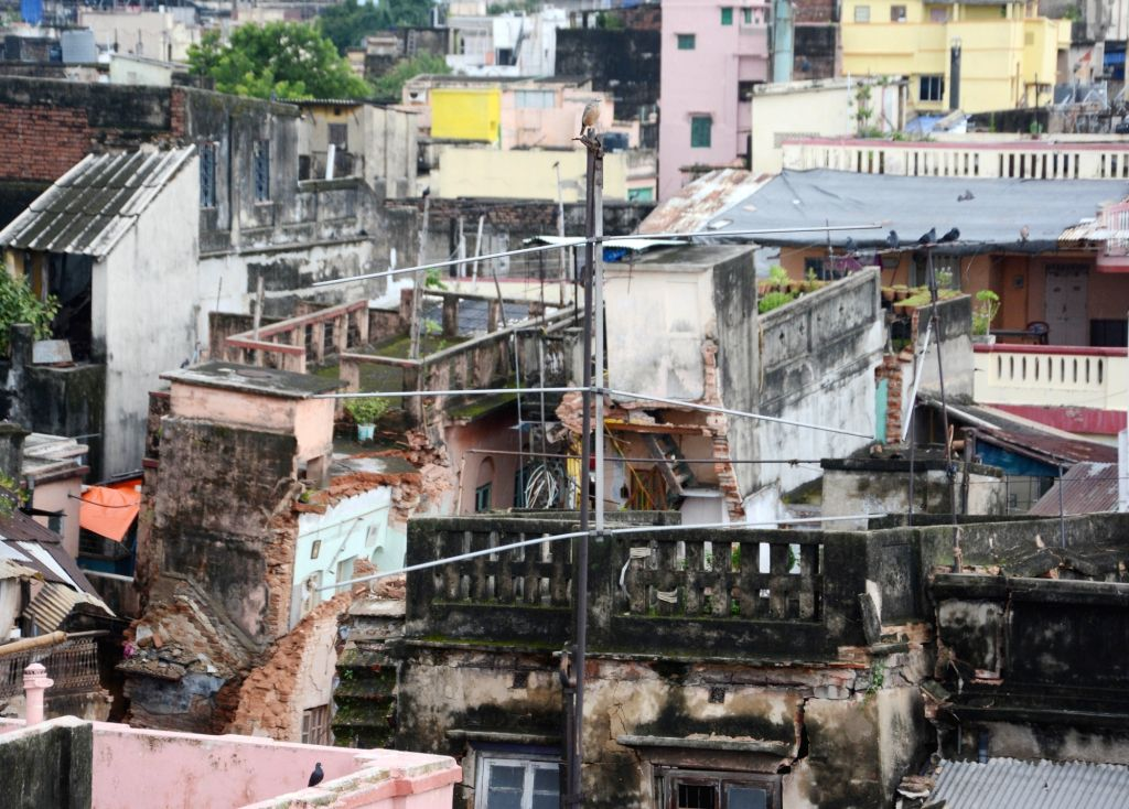 Kolkata: Houses in Central Kolkata's Bowbazar area damaged in underground tunnelling work for the East-West Metro Project, in Kolkata on Sep 5, 2019. (Photo: IANS)