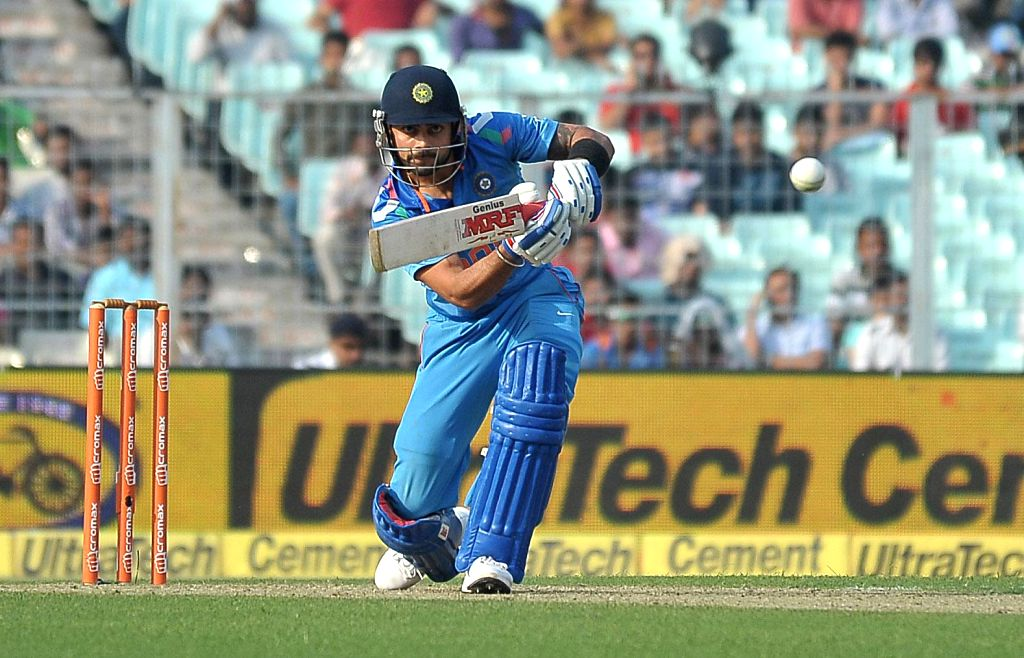 Indian batsman Virat Kohli in action during the 4th ODI between India and Sri Lanka at the Eden Gardens in Kolkata, on Nov 13, 2014. - Virat Kohli