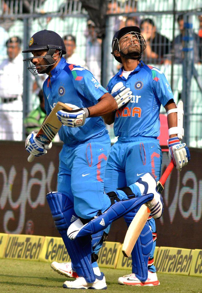 Indian batsmen Rohit Sharma and Ajinkya Rahane during the 4th ODI between India and Sri Lanka at the Eden Gardens in Kolkata, on Nov 13, 2014. - Rohit Sharma