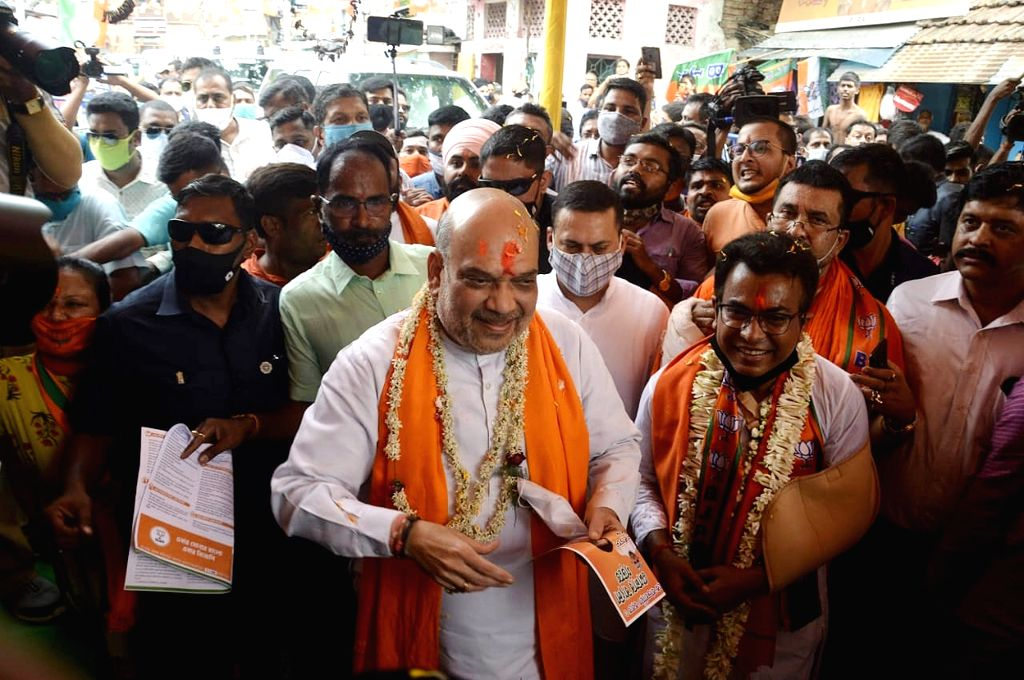 Kolkata: Indian Minister of Home Affairs Amit Shah at a door to door election campaign for the State Assembly election in Kolkata on Friday, April 9th, 2021.(photo:IANS) - Affairs Amit Shah