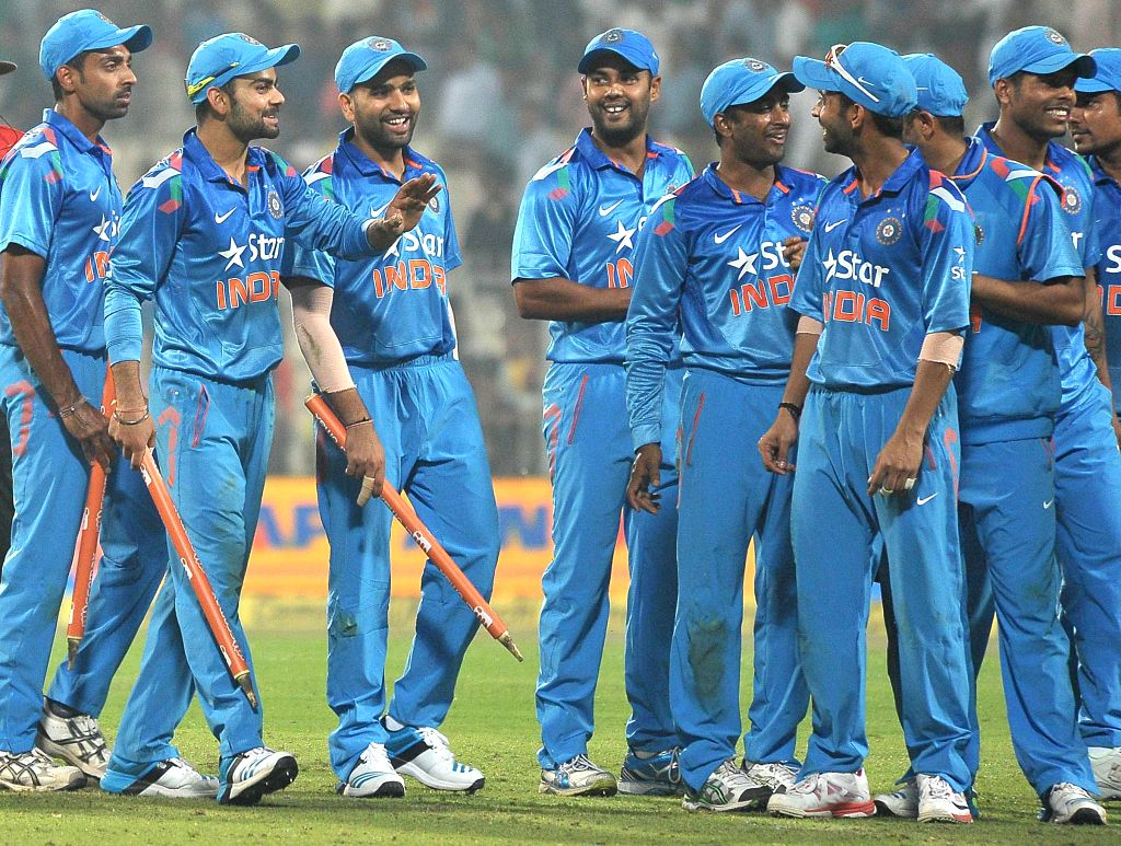 Indian players celebrate after winning the 4th ODI between India and Sri Lanka at the Eden Gardens in Kolkata, on Nov 13, 2014.