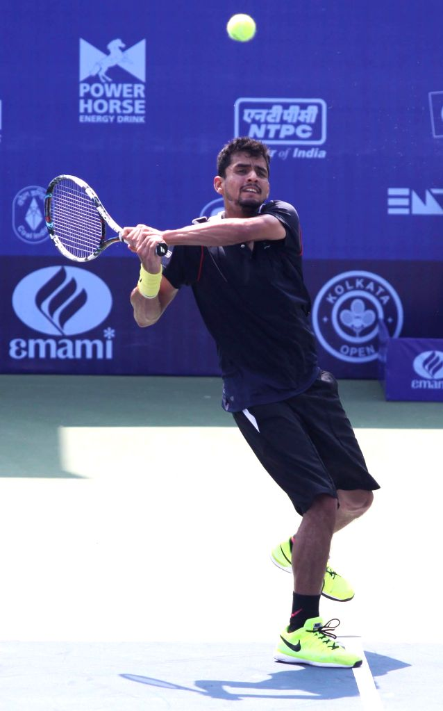 Indian tennis player Sanam Singh in action during the Emami Kolkata Open 2015- ATP Challenger on Feb 23, 2015. - Sanam Singh