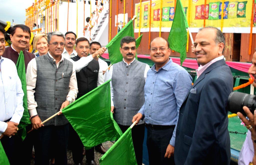 :Kolkata: Inland Waterways Authority of India (IWAI) Vice Chairman Pravin Pandey, Shipping Secretary Gopal Krishna and Kolkata Port Trust (KoPT) Chairman Vinit Kumar flag off the container cargo MV ...
