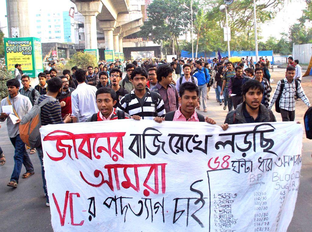 Jadavpur University students participate in a rally against the vice chancellor of the varsity Avijit Chakraborty in Kolkata on Jan 9, 2015. - Avijit Chakraborty