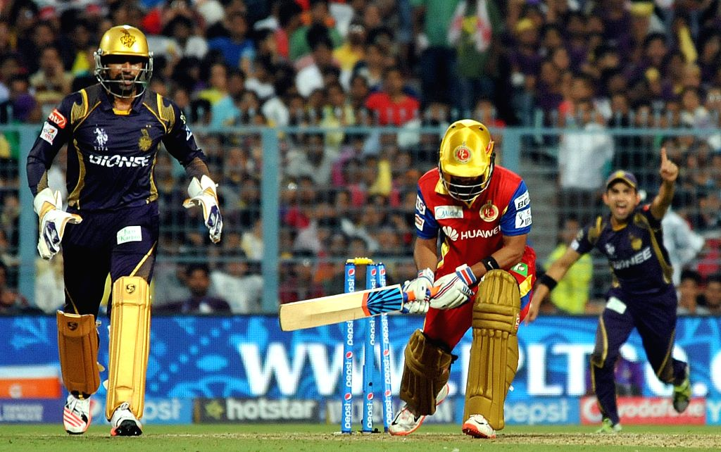 KKR players celebrate fall of wicket during the IPL match between Kolkata Knight Riders (KKR) and Royal Challengers Bangalore (RCB) at Eden Gardens in Kolkata on April 11, 2015.