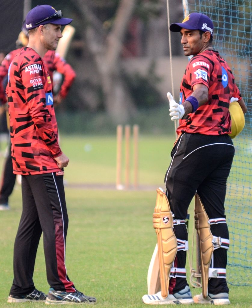 Kolkata Knight Riders' assistant coach Simon Katich and player Robin Uthappa during a practice session in Kolkata, on March 14, 2019.