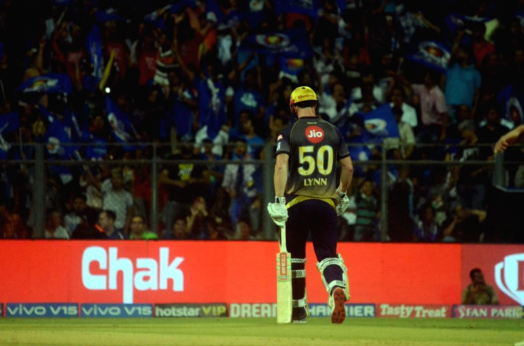 Kolkata Knight Riders' Chris Lynn walks back to the pavilion after getting dismissed during the 56th match of IPL 2019 between Kolkata Knight Riders and Mumbai Indians at Wankhede Stadium in ...