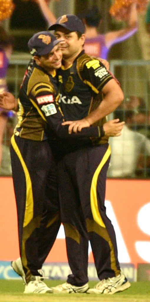 Kolkata Knight Riders' Dinesh Karthik and Piyush Chawla celebrate after winning the Eliminator match of IPL 2018 against Rajasthan Royals at the Eden Gardens in Kolkata on May 23, 2018.