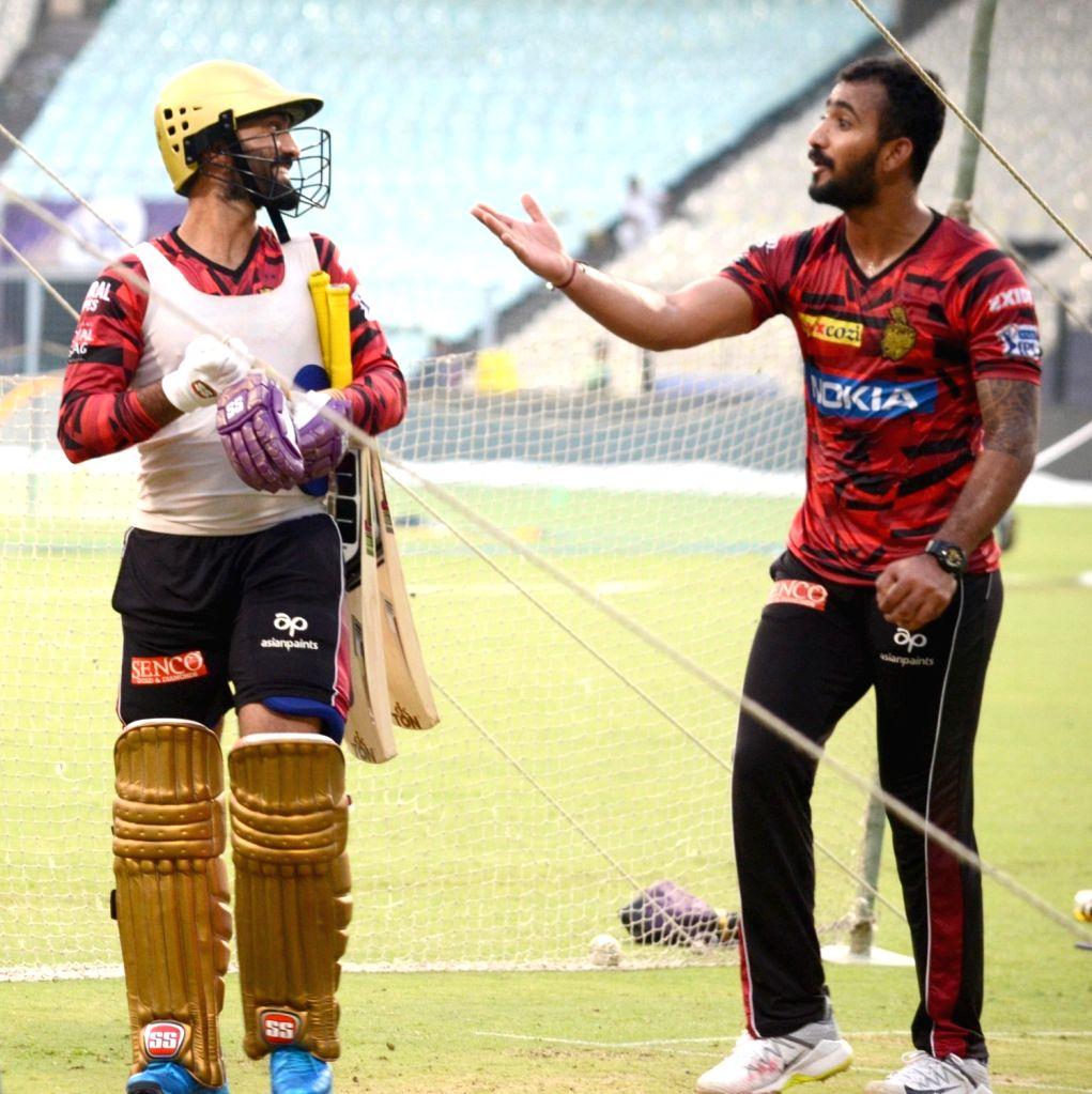 Kolkata Knight Riders' Dinesh Karthik and Prithvi Raj during a practice session in Kolkata, on April 16, 2019.
