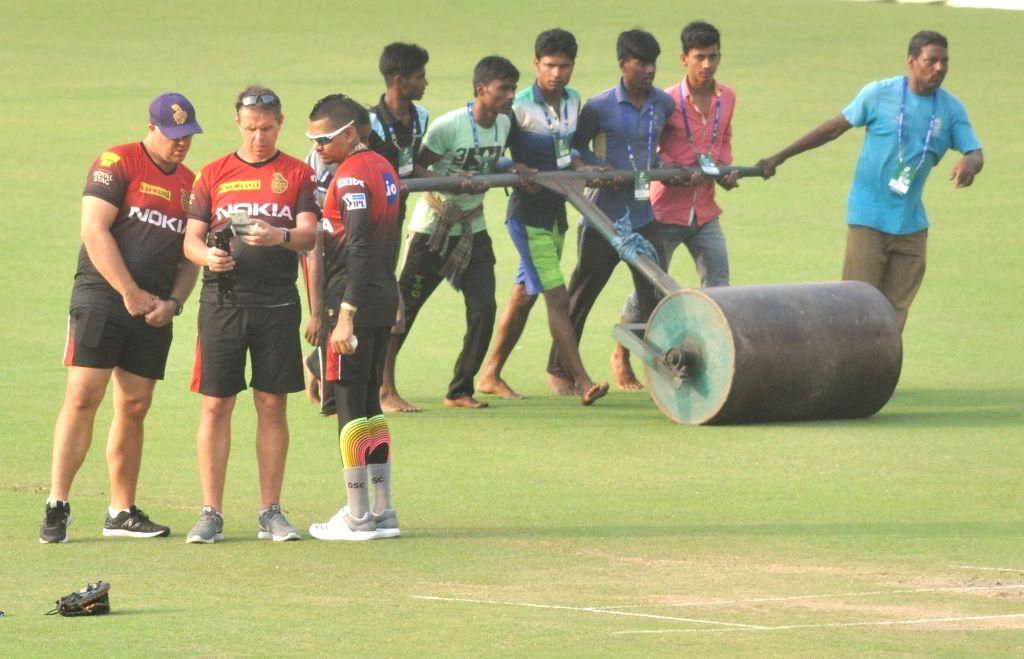 Kolkata Knight Riders (KKR) bowling coach Heath Streak and Sunil Narine during a practice session at Eden Gardens in Kolkata on April 6, 2018.