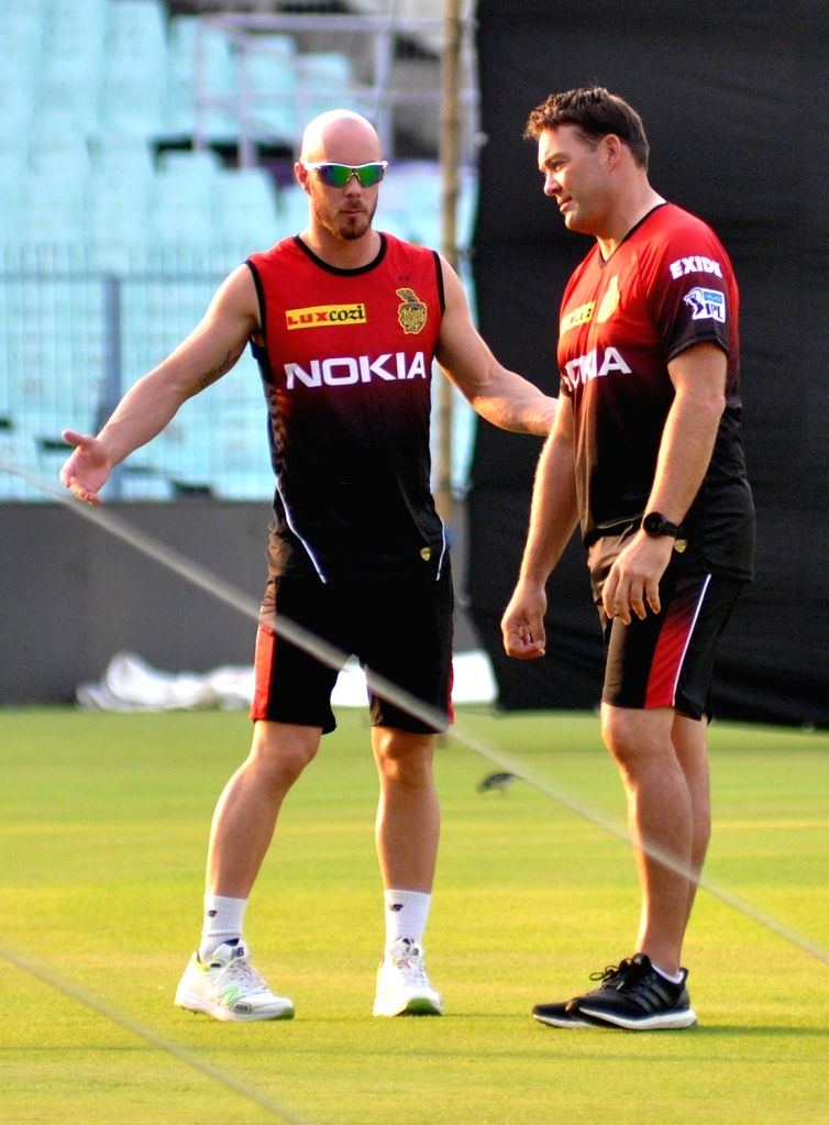 Kolkata Knight Riders (KKR) head coach Jacques Kallis with player Chris Lynn during the team's practice session at at Eden Gardens in Kolkata on April 5, 2018.