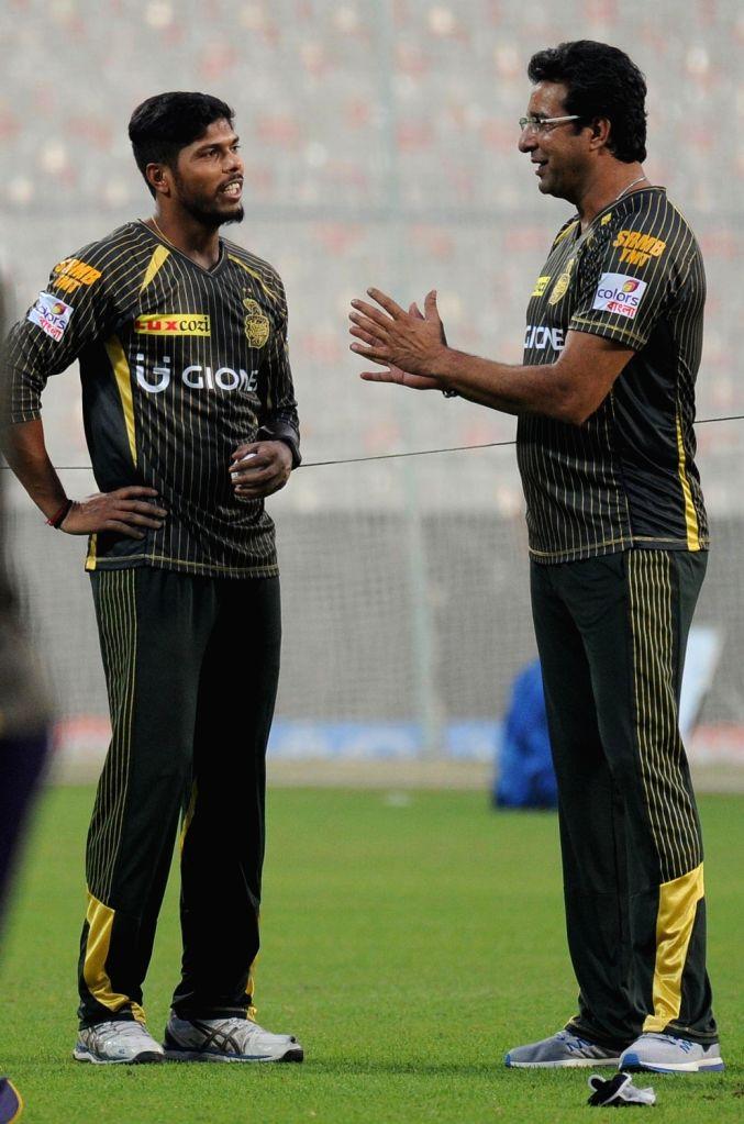 Kolkata Knight Riders player Umesh Yadav and coach Wasim Akram during a practice session at Eden Gardens in Kolkata on April 12, 2016. - Umesh Yadav