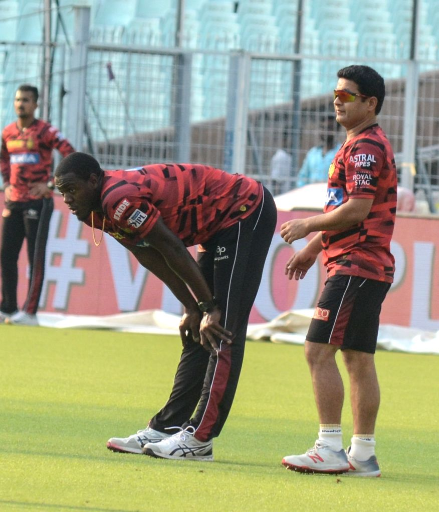 Kolkata Knight Riders players Carlos Brathwaite and Piyush Chawla during a practice session at the Eden Gardens in Kolkata, on April 24, 2019.