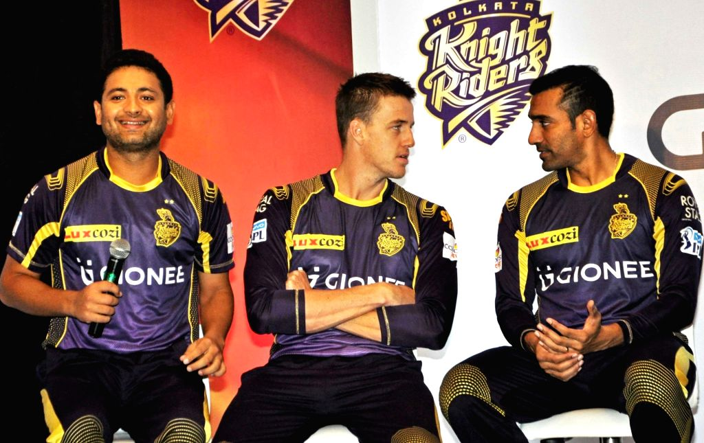 Kolkata Knight Riders players Robin Uthappa, Morne Morkel and Piyush Chawla during a programme organised to launch the team jersey in Kolkata on April 11, 2016.