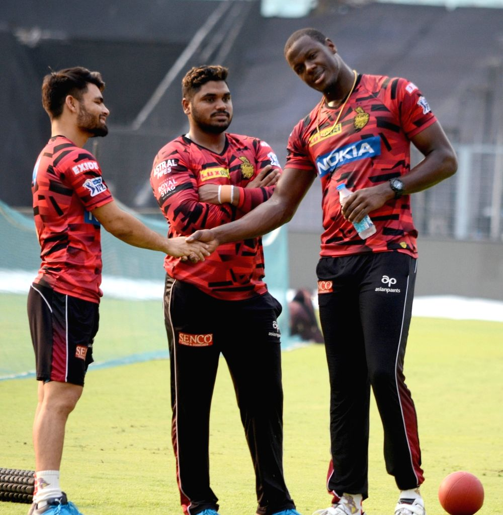 Kolkata Knight Riders' Rinku Singh and Andre Russell during a practice session in Kolkata, on April 16, 2019. - Rinku Singh