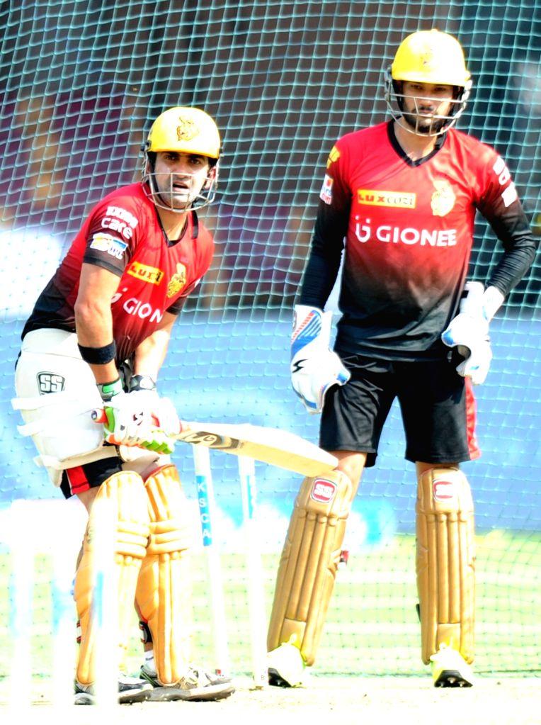Kolkata Knight Riders skipper Gautam Gambhir and Sheldon Jackson during a practice session ahead of their playoff match against Sunrise Hyderabad at Chinnaswamy Stadium in Bengaluru on May ...