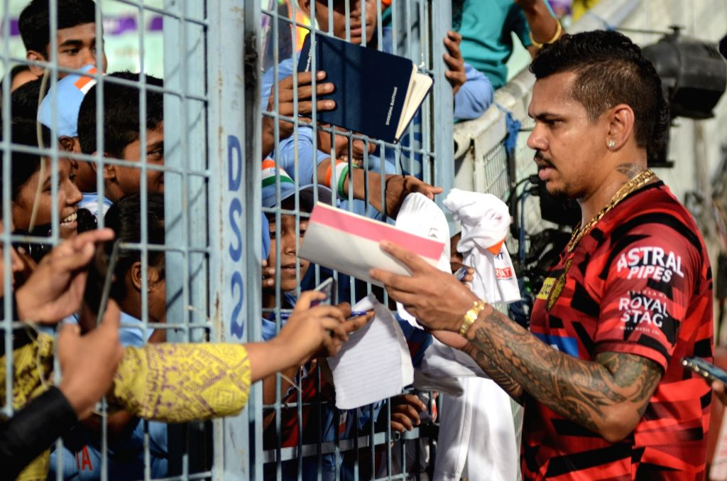 Kolkata Knight Riders' Sunil Narine signs autographs for fans during a practice session at the Eden Gardens in Kolkata, on April 24, 2019.