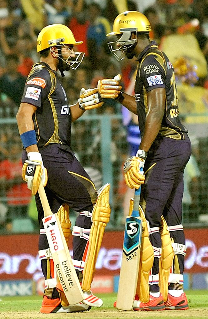 Kolkata Knight Riders batsmen Robin Uthappa and Andre Russell during an IPL-2015 match between Chennai Super Kings and Kolkata Knight Riders in Kolkata, on April 30, 2015.