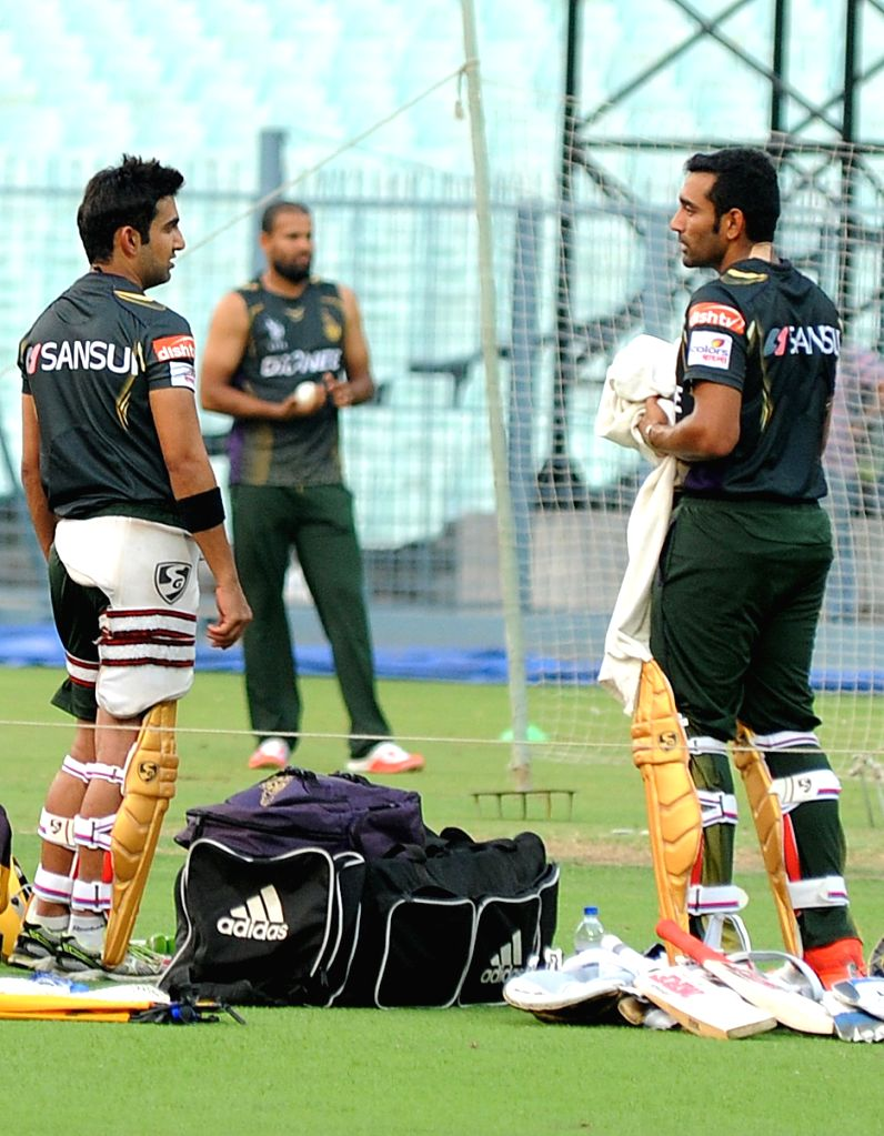 Kolkata Knight Riders captain Gautam Gambhir with teammate Robin Uthappa during a practice session for the upcoming IPL matches in Kolkata, on April 4, 2015. - Gautam Gambhir