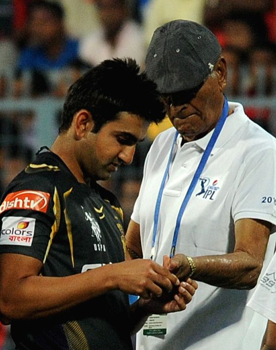 Kolkata Knight Riders captain Gautam Gambhir interacts with Eden Gardens` pitch curator Prabir Mukherjee ​​at the Eden Gardens after rains disrupted an IPL-2015 match between Kolkata ... - Gautam Gambhir and Prabir Mukherjee