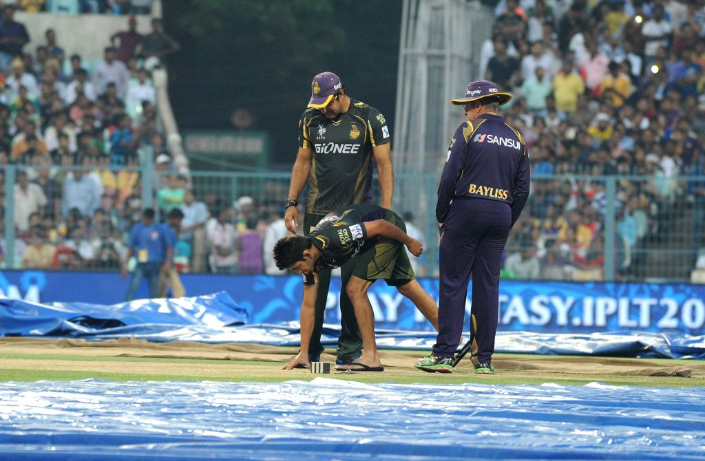 Kolkata Knight Riders (KKR) head coach Trevor Bayliss, KKR bowling coach Wasim Akram and KKR captain Gautam Gambhir inspect the ​field​ ​​at the Eden Gardens after rains disrupted an ... - Gautam Gambhir