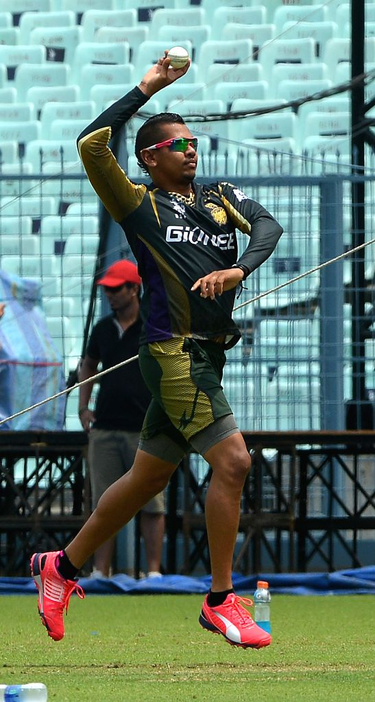 :Kolkata: Kolkata Knight Riders player Sunil Narine during a practice session at the Eden Gardens in Kolkata, on April 7, 2015. (Photo: IANS). - Gautam Gambhir