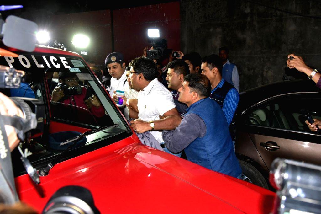 Kolkata: Kolkata police and CBI officials seen outside Kolkata police commissioner Rajeev Kumar's official residence on Loudon Street, Kolkata on Feb 3, 2019. There was a high drama in front of Kumar's residence on Sunday as a group CBI officers appr - Rajeev Kumar