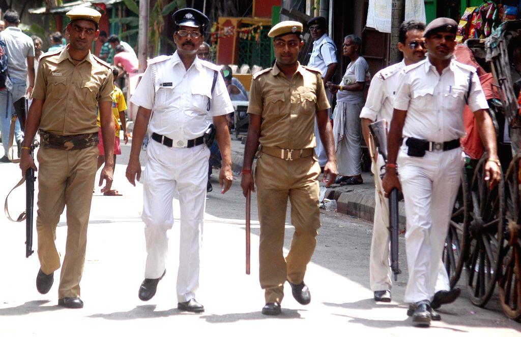 Kolkata Police conducts flag march a day after Kolkata Municipal Corporation polls in Kolkata, on April 19, 2015.