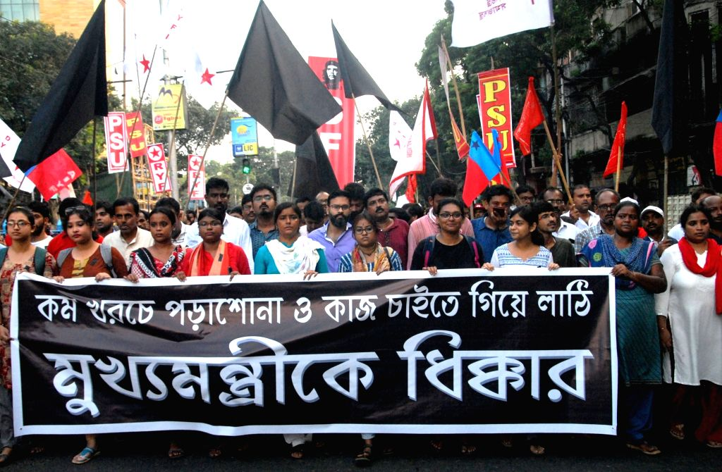Kolkata: Left activists participate in a rally to protest to against violent police action on students and youth wing activists of the Left parties during Sigur to Nabanna rally; in Kolkata on Sep 14, 2019. (Photo: IANS)