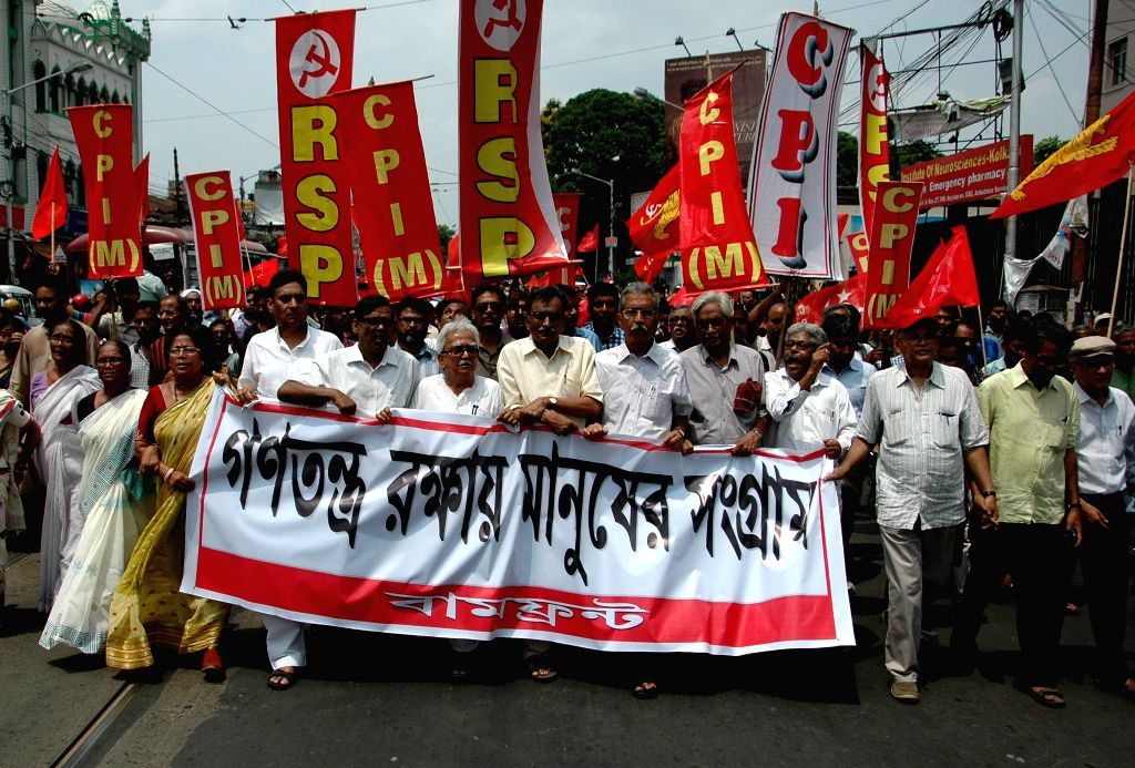 Left front Chairman Biman Bose, CPI(M) State Secretary and Leader of Opposition in West Bengal assembly Surjo Kanta Mishra with others left leaders take out a rally during a 12 hour general ... - Biman Bose and Surjo Kanta Mishra
