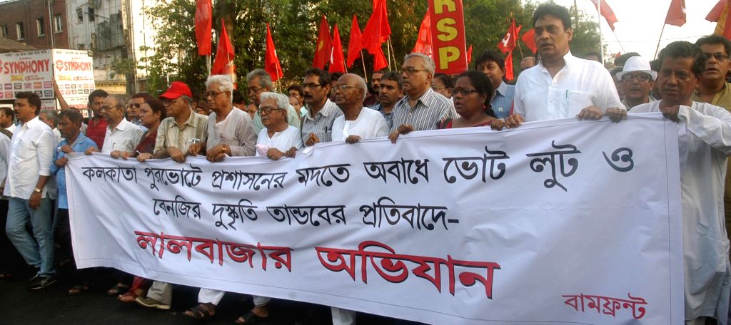 Left Front leaders led by Left Front chairman Biman Bose take part in `Lalbazar Abhiyan` - a protest against West Bengal Police in Kolkata on April 20, 2015. - Biman Bose