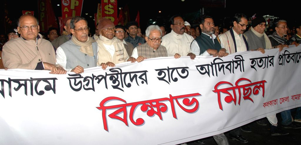 Left front leaders led by their chairman Biman Bose participate in a rally organised to protest against the recent violence is Assam that left 73 dead, in Kolkata on Dec 30, 2014. - Biman Bose