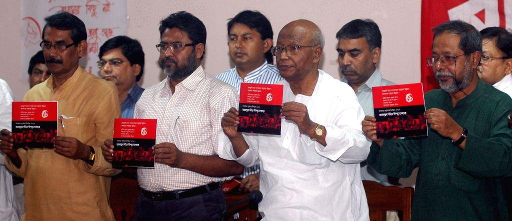 Left Front leaders release manifesto for upcoming Kolkata Municipal Corporation polls in Kolkata, on March 30, 2015.