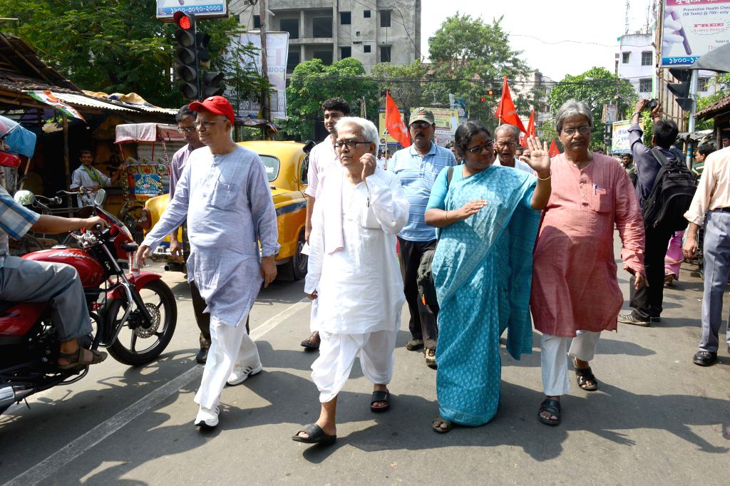 Left leaders led by Left Front chairman Biman Bose and Rabin Deb participate in election campaign ahead of KMC polls in Kolkata, on April 12, 2015. - Biman Bose
